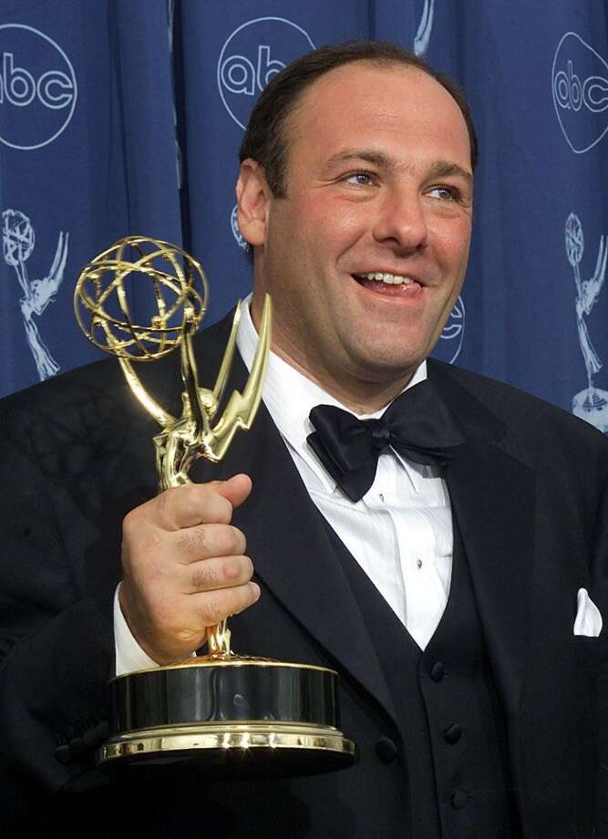 "This September 10, 2000 file photo shows US actor James Gandolfini holding his trophy for the ""Lead Actor in a Drama Series"" category for his role in ""The Sopranos"" during the 52nd Annual Primetime Emmy Awards at the Shrine Auditorium in Los Angeles.  Gandofini, who starred as mob boss Tony Soprano in ""The Sopranos"", died while on vacation in Italy on June 19, 2013. He was 51.     AFP PHOTO / Files / Scott NELSONSCOTT NELSON/AFP/Getty Images"
