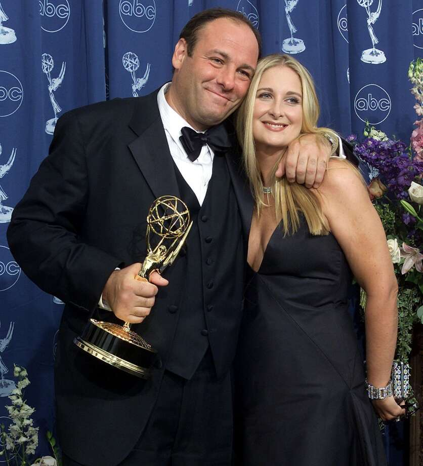 "This September 10, 2000 file photo shows US ator James Gandolfini with  his wife Marcy as he holds his trophy for the ""Lead Actor in a Drama Series"" category for his role in ""The Sopranos"" during the  52nd Annual Primetime Emmy Awards at the Shrine Auditorium in Los Angeles.  Gandofini, who starred as mob boss Tony Soprano in ""The Sopranos"", died while on vacation in Italy on June 19, 2013. He was 51.     AFP PHOTO / Files / Scott NELSONSCOTT NELSON/AFP/Getty Images"