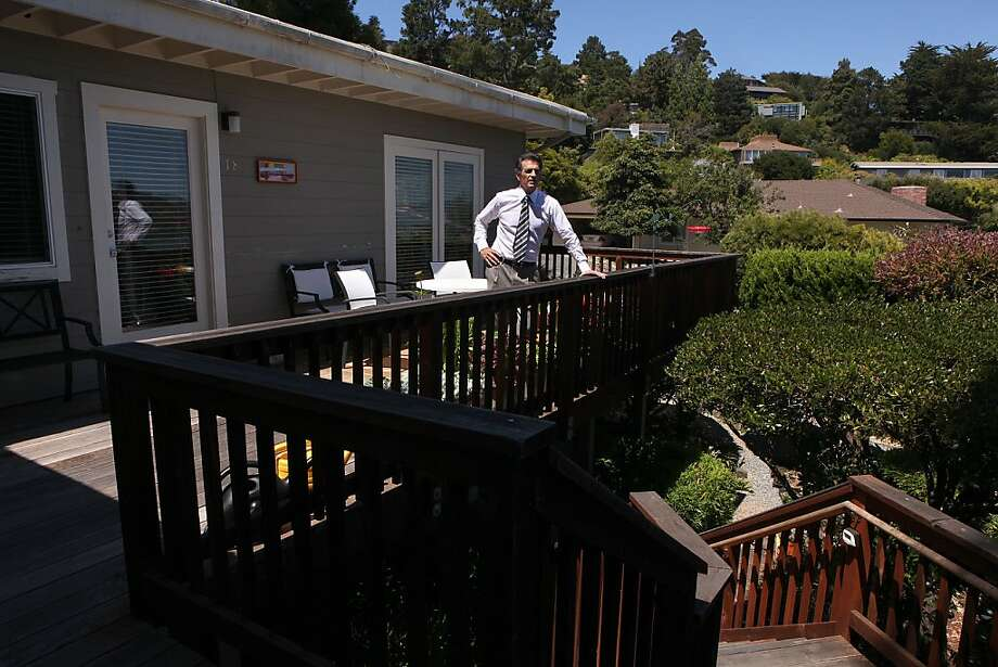 Real estate attorney Jeff Lerman stands at the entry to a duplex unit he bought in Tiburon from a flipper who had remodeled without city permits. Lerman brought it up to code. Photo: Liz Hafalia, The Chronicle