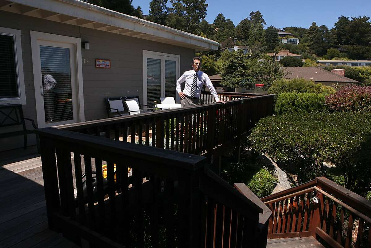 Real estate attorney Jeff Lerman stands at the entry to one of the duplex units he bought a few months ago in Tiburon, Calif., as rental property on Monday, June 17, 2013. Jeff bought it from a flipper who remodeled the duplex without city permits and inspections. Lerman replaced and fully remodeled both kitchens in compliance with the city of Tiburon, bringing electric and plumbing up to code.