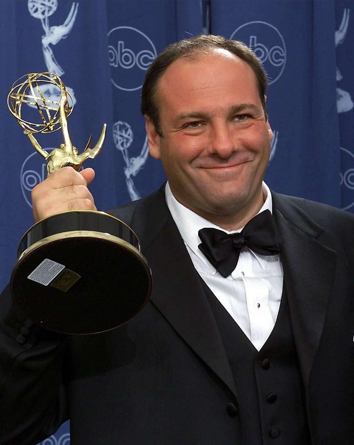 """This Sept. 10, 2000 file photo shows actor James Gandolfini with his award for outstanding lead in a drama series for his work in """"The Sopranos"""" at the 52nd Annual Primetime Emmy Awards in Los Angeles. HBO and the managers for Gandolfini say the actor died Wednesday, June 19, 2013, in Italy. He was 51."""