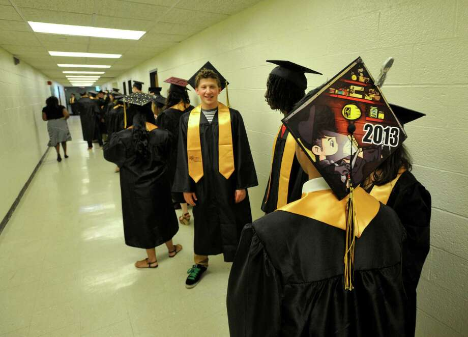 Scenes from the Academy of Information Technology and Engineering commencement ceremony at Rippowam Middle School in Stamford on Wednesday, June 19, 2013. Photo: Jason Rearick / Stamford Advocate