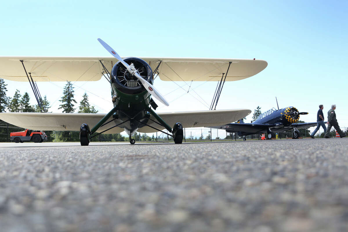 The Historic Flight Foundation's Waco UPF-7 biplane is shown parked outside the foundation at Paine Field on Tuesday, June 18, 2013. On June 22nd and 23rd the foundation will host Biplane Days, where about 20 biplanes will fly in. On Saturday rides will be offered on some of the planes.