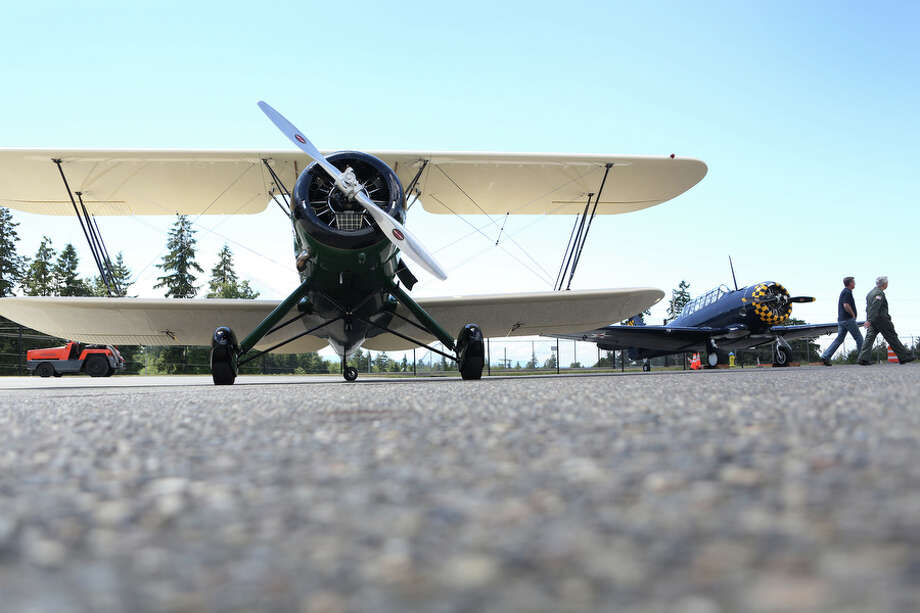 The Historic Flight Foundation's Waco UPF-7 biplane is shown parked outside the foundation at Paine Field on Tuesday, June 18, 2013.  On June 22nd and 23rd the foundation will host Biplane Days, where about 20 biplanes will fly in. On Saturday rides will be offered on some of the planes. Photo: JOSHUA TRUJILLO, SEATTLEPI.COM / SEATTLEPI.COM