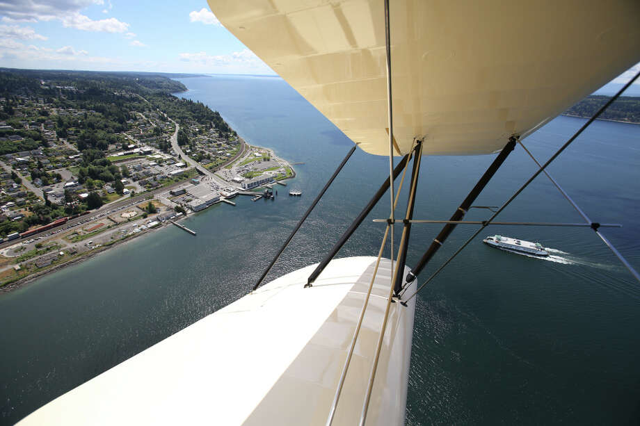 The Mukilteo ferry dock is seen from the Historic Flight Foundation's Waco UPF-7 biplane on Tuesday, June 18, 2013.  On June 22nd and 23rd the foundation will host Biplane Days, where about 20 biplanes will fly in. On Saturday rides will be offered on some of the planes. Photo: JOSHUA TRUJILLO, SEATTLEPI.COM / SEATTLEPI.COM