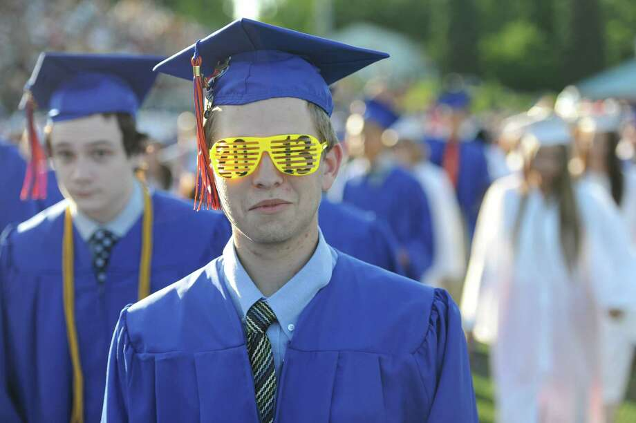 A student wears 2013 glasses at the Danbury High School commencement ceremony in Danbury, Conn. on Wednesday, June 19, 2013.  639 Danbury seniors crossed the stage at this year's graduation. Photo: Tyler Sizemore / The News-Times