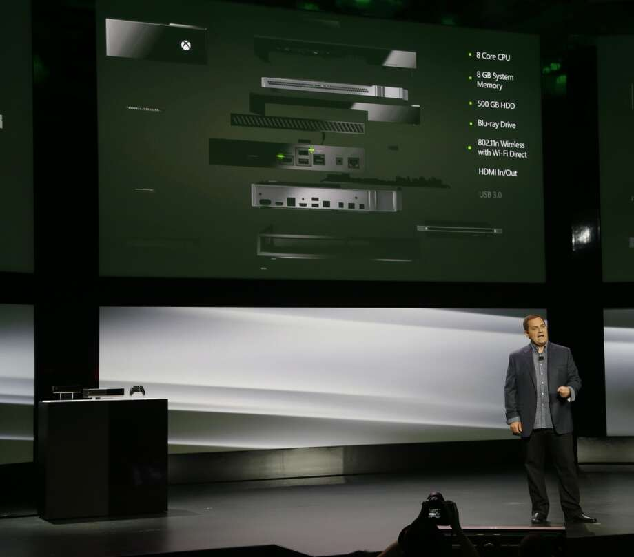 Marc Whitten, Microsoft Corp.'s chief production officer of interactive entertainment, talks about the features of the next-generation Xbox One entertainment and gaming console system, Tuesday, May 21, 2013, at an event in Redmond, Wash.