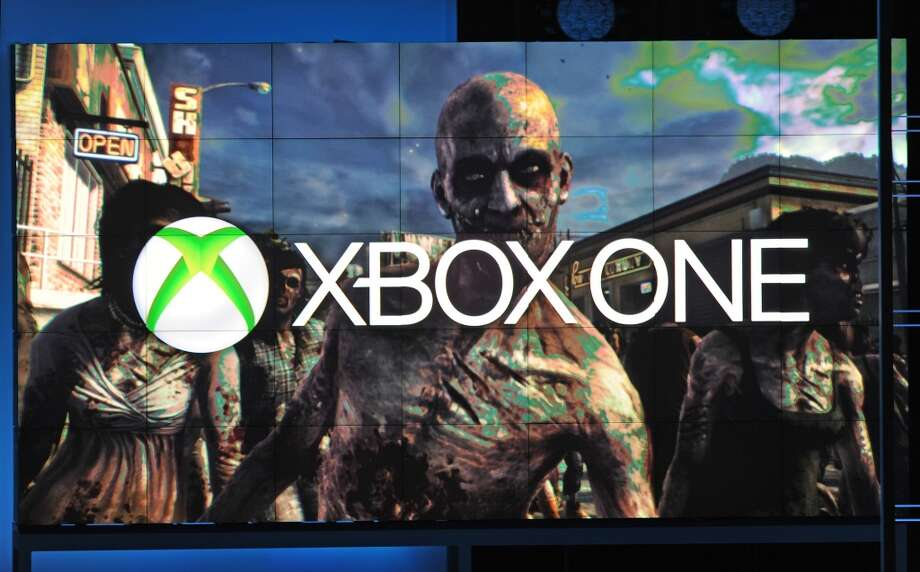 A frame from Dead Rising 3, exclusively for Xbox One, is seen under the Xbox One logo, at the Microsoft Xbox E3 2013 Media Briefing in Los Angeles on June 10, 2013. The press conference precedes the Electronic Entertainment Expo (E3) which takes place in Los Angeles June 11-13.