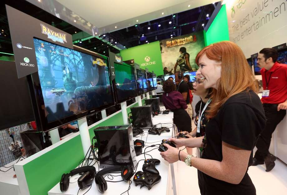 An E3 2013 attendee interacts with Rayman Legends for Xbox One at Microsoft's booth at E3 2013 in Los Angeles on Tuesday, June 11, 2013.