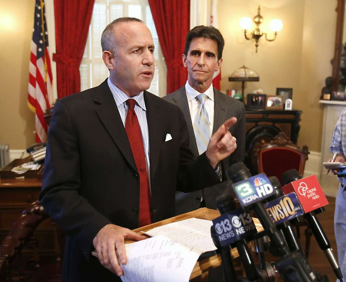 State Senate President Pro Tem Darrell Steinberg, D-Sacramento, left, accompanied by Senate Budget Committee chairman Mark Leno, D-San Francisco, announced that the Senate will take up a constitutional amendment to address a budget bill that threatens public access to information held by local governments, while talking to reporters at his Capitol office in Sacramento, Calif., Wednesday June 19, 2013. Steinberg's announcement came after Assembly Speaker John Perez, D-Los Angeles, announced that the Assembly would pass a measure that will maintain a requirement for cities and counties to comply with the California Public Records Act. (AP Photo/Rich Pedroncelli)