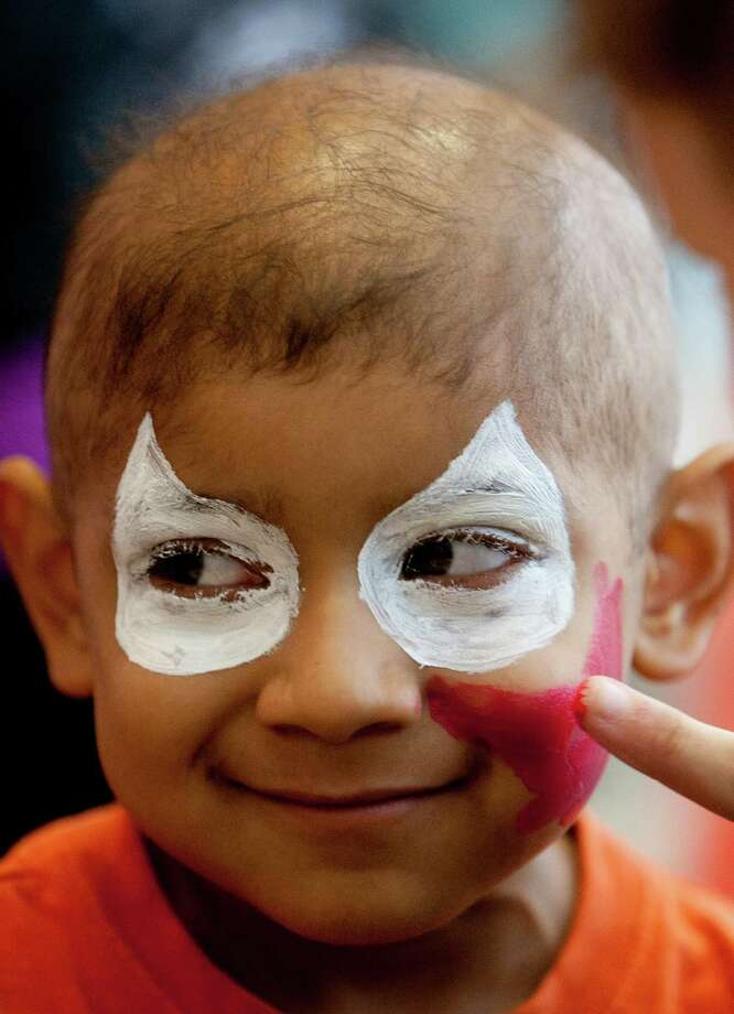Andy Garcia, 5, smiles as he gets his face painted during Camp Periwinkle Day at Texas Children's Hospital, Wednesday, June 19, 2013, in Houston. Photo: Cody Duty, Houston Chronicle / © 2013 Houston Chronicle
