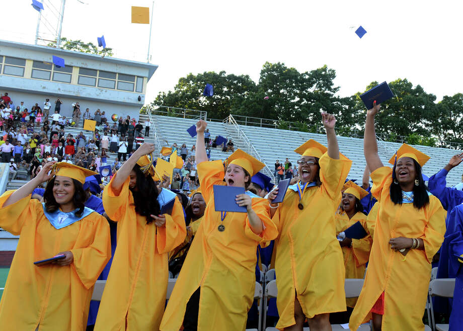 Graduates cheer at the conclusion of Warren Harding High School's 87th Annual Commencement ceremony which was held at Central High School's Kennedy Stadium in Bridgeport, Conn. on Wednesday June 19, 2013. Photo: Christian Abraham / Connecticut Post