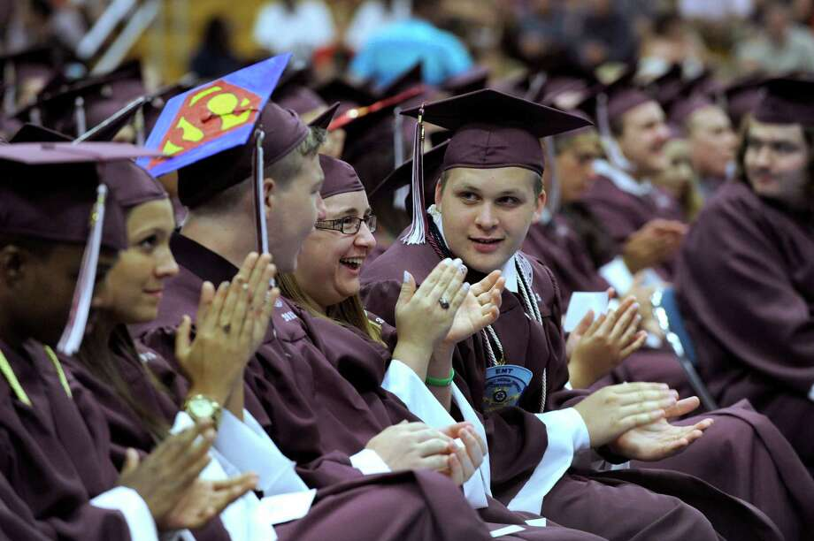 Graduating seniors applaud a speaker Wednesday evening. Bethel High School held its graduation ceremonies Wednesday, June 19, 2013, at the O'Neill Center at Western Connecticut State University, in Danbury, Conn. Photo: Carol Kaliff / The News-Times
