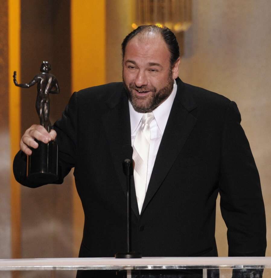 "This Jan. 27, 2008 file photo shows actor James Gandolfini accepting the award for outstanding performance by a male actor in a drama series for his work in ""The Sopranos"" at the 14th Annual Screen Actors Guild Awards in Los Angeles. HBO and the managers for Gandolfini say the actor died Wednesday, June 19, 2013, in Italy. He was 51. (AP Photo/Mark J. Terrill, file)"