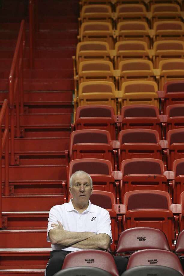 Spurs coach Gregg Popovich sits by himself during practice one day after his team failed to close out the Heat in Game 6.
