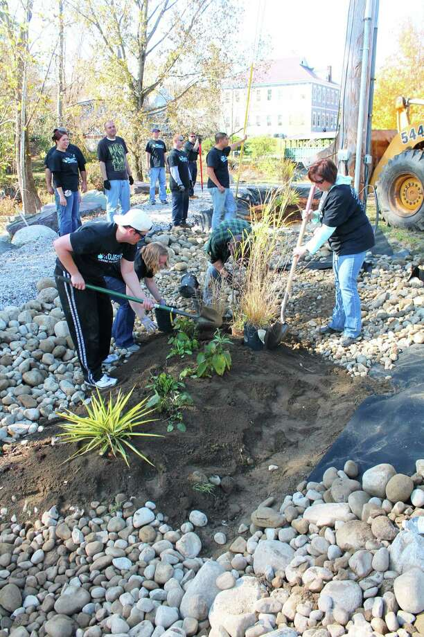 Six Flags Great Escape volunteers restore the Village of Granville?s D&H Rail Trail after Tropical Storm Irene. (Parks & Trails New York)