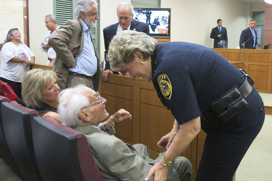 Sheriff Susan Pamerleau congratulates Bill Sinkin during a ceremony honoring Sinkin at Bexar County Commissioners Court on Tuesday. Photo: San Antonio Express-News
