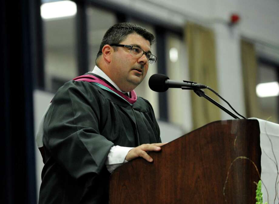 Bethel High School Principal Christopher M. Troetti welcomes the audience Wednesday evening. Bethel High School held its graduation ceremonies Wednesday, June 19, 2013, at the O'Neill Center at Western Connecticut State University, in Danbury, Conn. Photo: Carol Kaliff / The News-Times