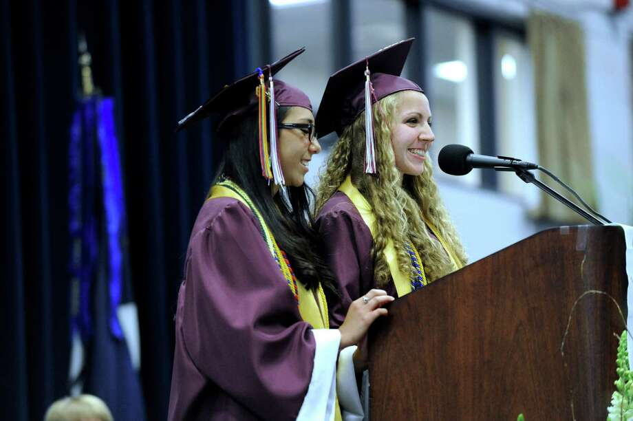 Senior Class Co-Presidents Laura Almonacid, left, and Megan Marx give their message Wednesday evening. Bethel High School held its graduation ceremonies Wednesday, June 19, 2013, at the O'Neill Center at Western Connecticut State University, in Danbury, Conn. Photo: Carol Kaliff / The News-Times