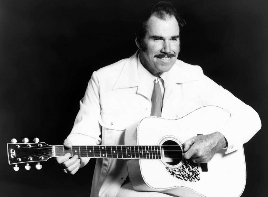 FILE - This undated file photo shows country singer Slim Whitman. Whitman died Wednesday, June 19, 2013 of heart failure in Florida. He was 90. Whitman's career began in the late 1940s, and his tenor falsetto and ebony mustache and sideburns became global trademarks. They were also an inspiration for countless jokes thanks to the ubiquitous 1980s and 1990s TV commercials that pitched his records. (AP Photo, file)