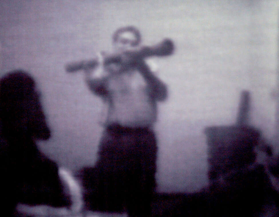 Still image from a surveillance videotape shows a man wielding an inert, inoperable shoulder fired rocket launcher to suspects in a federal terrorism sting in Albany in volving Mohammed Hossain, and Yassin Aref.