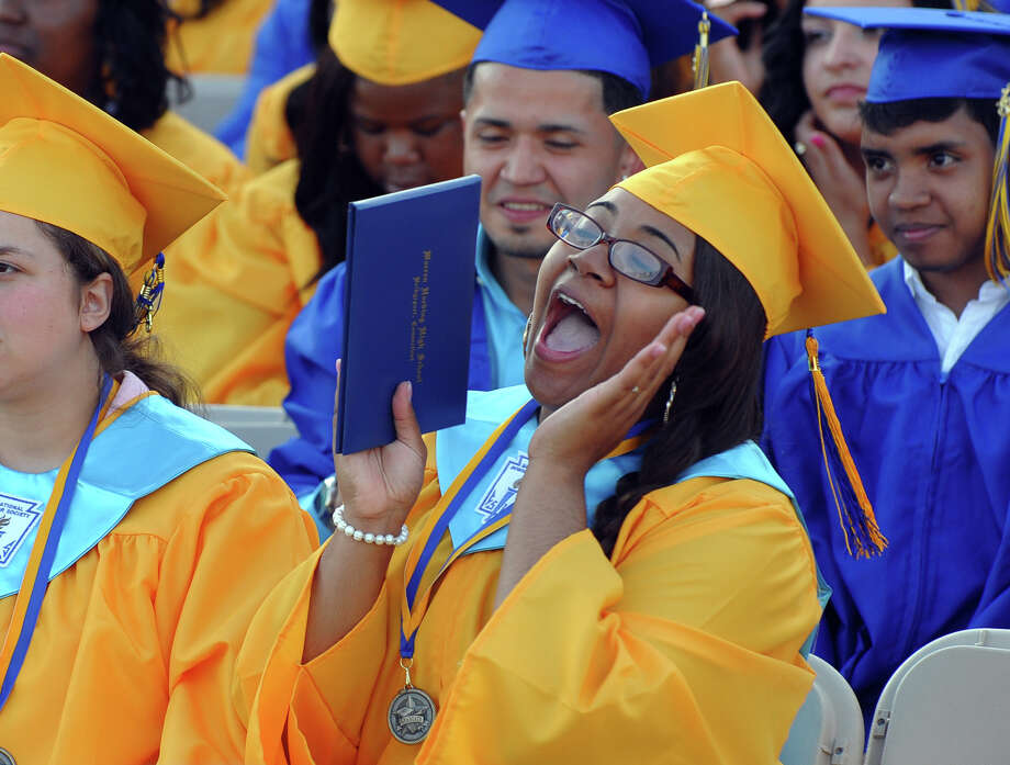 Graduate Catherine Pezzella cheers for a fellow graduate, during Warren Harding High School's 87th Annual Commencement ceremony which was held at Central High School's Kennedy Stadium in Bridgeport, Conn. on Wednesday June 19, 2013. Photo: Christian Abraham / Connecticut Post
