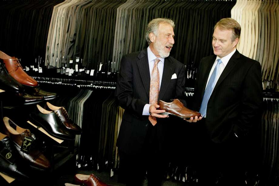 Portrait of  Men's Wearhouse CEO George Zimmer, left,  who is passing the reins to Douglas Ewert at the San Francisco's downtown store on Market St.  Zimmer will continue to be the company's spokesperson. (Photog by Vasna Wilson/Freelance) Photo: Vasna Wilson WilsonManish Tandon, Freelance / Vasna Wilson