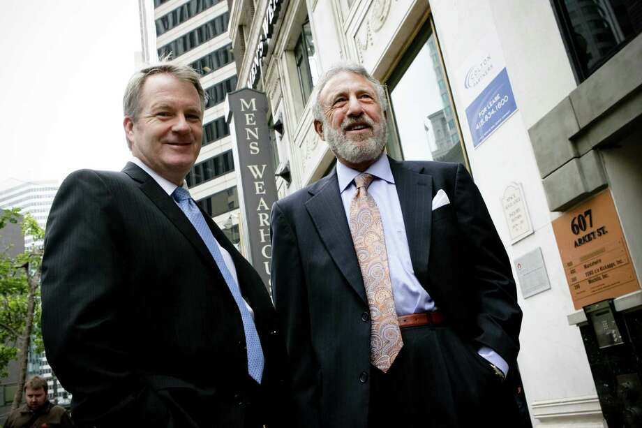 Men's Warehouse founder George Zimmer (right) was terminated Wednesday as executive chairman by the company's board. The move comes two years after Douglas Ewart (left) replaced Zimmer as CEO. Photo: Houston Chronicle