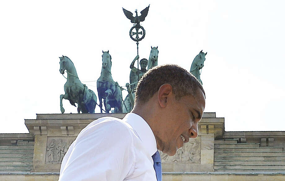 President Barack Obama walks off the stage Wednesday after making his speech at Berlin's Brandenburg Gate near the U.S. Embassy. Obama, in his first presidential visit to Berlin, encountered some scepticism from Germany in talks on secret U.S. surveillance practices. Photo: Jewel Samad / AFP / Getty Images