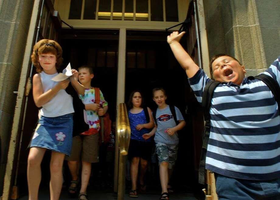 Summer vacation will begin soon but will any kid be as happy as Nathan Pettograsso, right, was as he jumped for joy on June 25, 2003, the last day of class at Voorheesville Elementary School. Photo by Michael P. Farrell