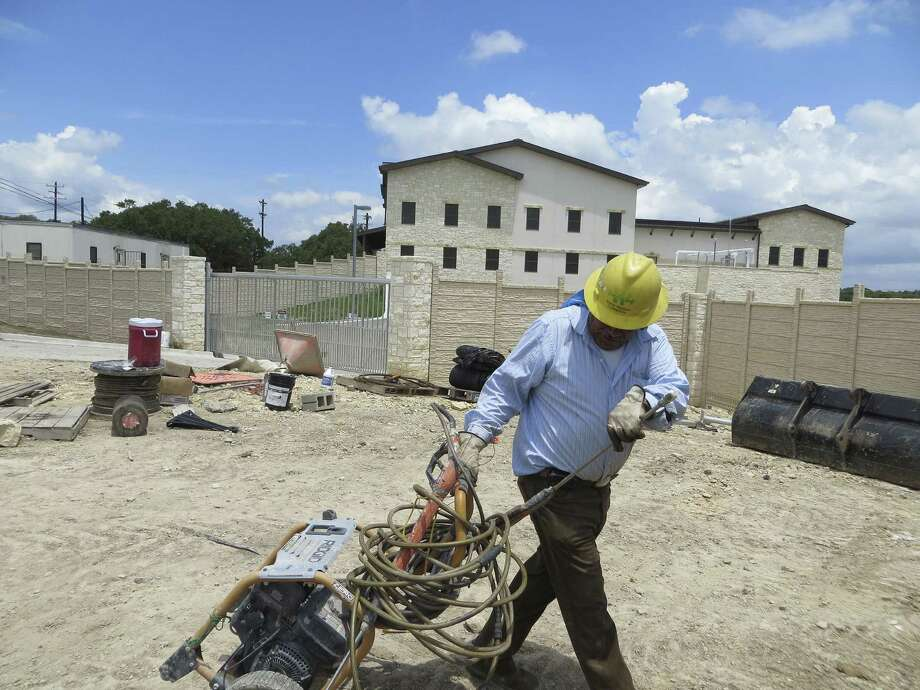 Archer Western Construction worker Arfuro Tinico rounds up gear before the company checks out after completing work on the city of Boerne's new $27 million wastewater treatment plant. The facility will serve the northern side of Boerne, including the Esperanza subdivision. Photo: Zeke Maccormack / San Antonio Express-News