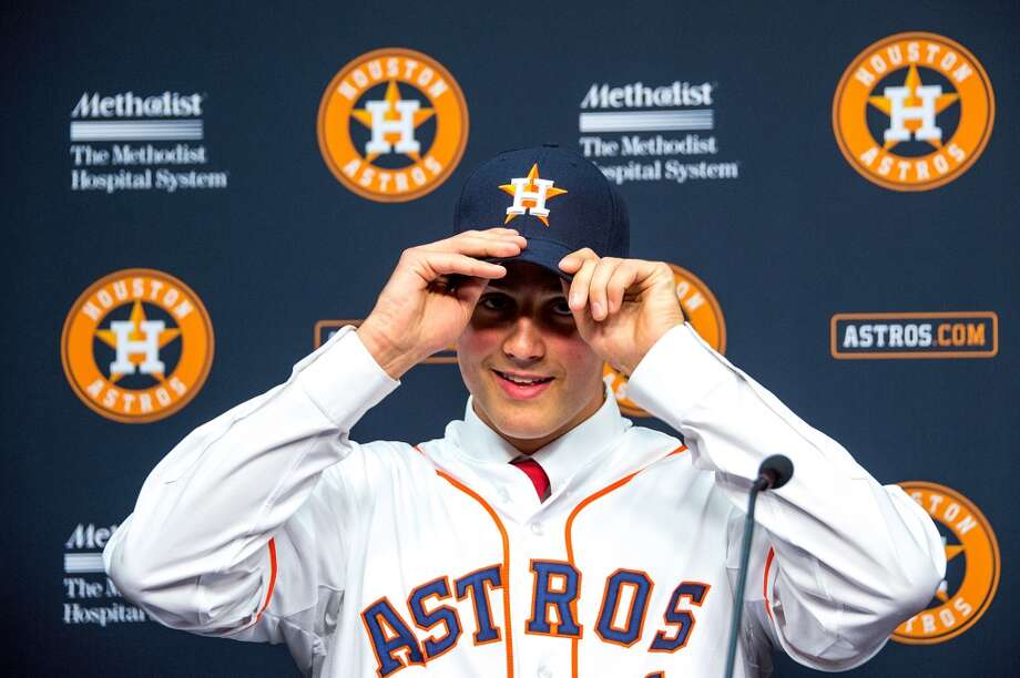Astros first round draft choice Mark Appel dons a new cap as he is introduced to the media. Photo: Smiley N. Pool, Houston Chronicle
