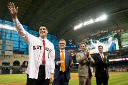 Astros first round draft choice Mark Appel waves to the crowd as he is introduced during the fifth inning in the game against the Brewers on June 19.