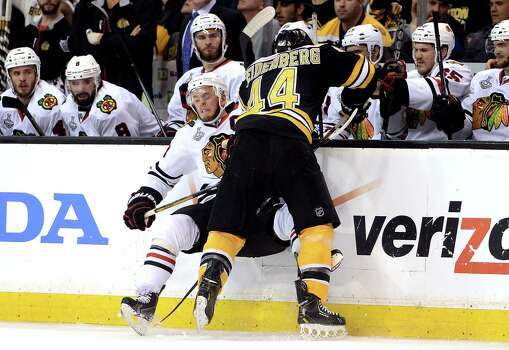 BOSTON, MA - JUNE 19: Dennis Seidenberg #44 of the Boston Bruins collides with Jonathan Toews #19 of the Chicago Blackhawks along the boards in Game Four of the 2013 NHL Stanley Cup Final at TD Garden on June 19, 2013 in Boston, Massachusetts. Photo: Harry How, Getty Images / 2013 Getty Images