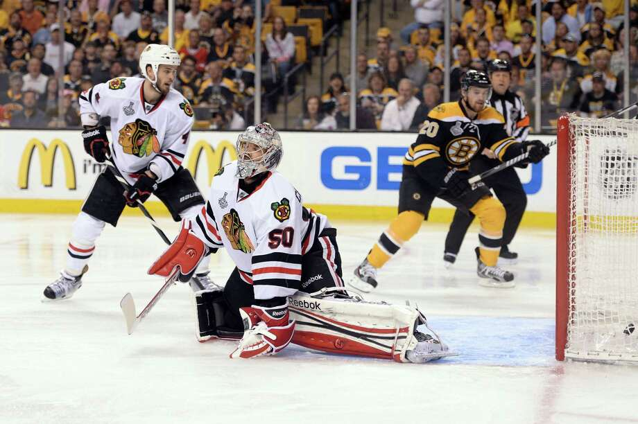 BOSTON, MA - JUNE 19:  Corey Crawford #50 of the Chicago Blackhawks fails to make a save on a shot by Patrice Bergeron #37 of the Boston Bruins (not pictured) during the third period in Game Four of the 2013 NHL Stanley Cup Final at TD Garden on June 19, 2013 in Boston, Massachusetts. Photo: Harry How, Getty Images / 2013 Getty Images