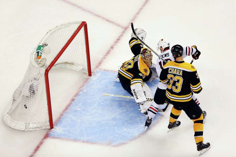 BOSTON, MA - JUNE 19:  Brent Seabrook #7 of the Chicago Blackhawks (not pictured) scores a game winning goal against Tuukka Rask #40 of the Boston Bruins in overtime as Jonathan Toews #19 and Zdeno Chara #33 looks on in Game Four of the 2013 NHL Stanley Cup Final at TD Garden on June 19, 2013 in Boston, Massachusetts. Photo: Jim Rogash, Getty Images / 2013 Getty Images