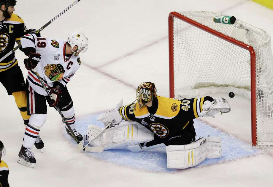 Chicago Blackhawks center Jonathan Toews (19) watches the winning goal by teammate Brent Seabrook, not shown, sail past Boston Bruins goalie Tuukka Rask (40), of Finland, during the first overtime period in Game 4 of the NHL hockey Stanley Cup Finals, Wednesday, June 19, 2013, in Boston. Chicago won 6-5. (AP Photo/Charles Krupa) Photo: Charles Krupa, Associated Press / AP