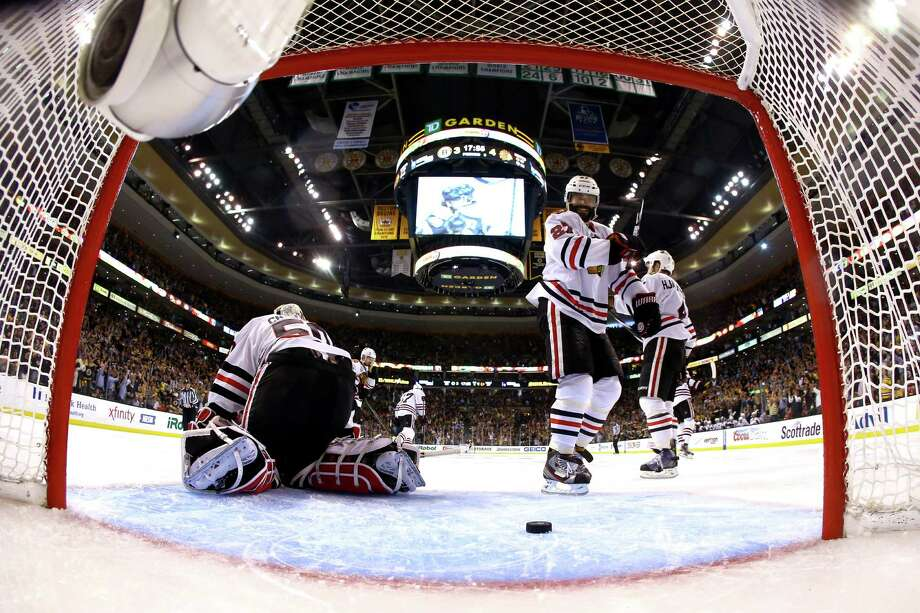 BOSTON, MA - JUNE 19:  Corey Crawford #50 of the Chicago Blackhawks kneels on the ice after allowing a goal against the Boston Bruins in Game Four of the 2013 NHL Stanley Cup Final at TD Garden on June 19, 2013 in Boston, Massachusetts. Photo: Harry How, Getty Images / 2013 Getty Images