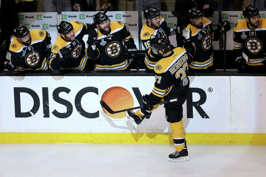 BOSTON, MA - JUNE 19: Patrice Bergeron #37 of the Boston Bruins celebrates with teammates after a goal against the Chicago Blackhawks in Game Four of the 2013 NHL Stanley Cup Final at TD Garden on June 19, 2013 in Boston, Massachusetts. Photo: Bruce Bennett, Getty Images / 2013 Getty Images