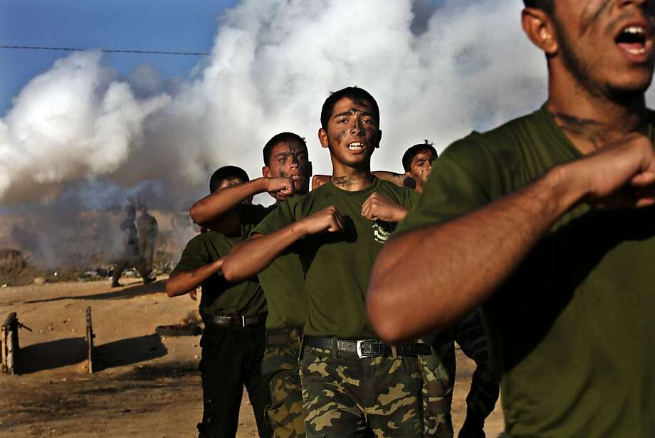 Palestinian youths march during a military style exercise run by Hamas during a scouting summer camp next to the border between Egypt and Rafah, southern Gaza Strip, Wednesday, June 19, 2013. (AP Photo/Adel Hana) Photo: Adel Hana, Associated Press