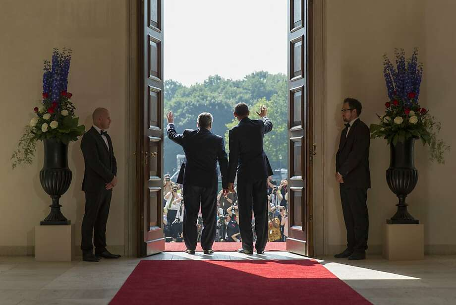 BERLIN, GERMANY - JUNE 19:  In this handout photo provided by the German Government Press Office (BPA), U.S. President Barack Obama (R) and German President Joachim Gauck wave to the media waiting outside the Bellevue Palace on June 19, 2013 in Berlin, Germany. Obama is visiting Berlin for the first time during his presidency and his speech at the Brandenburg Gate is to be the highlight. Obama will be speaking close to the 50th anniversary of the historic speech by then U.S. President John F. Kennedy in Berlin in 1963, during which he proclaimed the famous sentence: Ich bin ein Berliner.  (Photo by Jesco Denzel/Bundesregierung via Getty Images) Photo: Handout, Getty Images