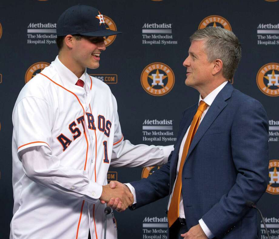 Houston Astros general manager Jeff Luhnow, right, shakes hands with newly signed pitcher Mark Appel during a baseball news conference Wednesday, June 19, 2013 in Houston, to announce his signing. Appel was selected with the first overall pick in the 2013 MLB First-Year Player Draft. Appel will make his professional debut for the Tri-City ValleyCats against the Lowell Spinners on Friday at 7 p.m. in Bruno Stadium. (AP Photo/David J. Phillip) Photo: David J. Phillip