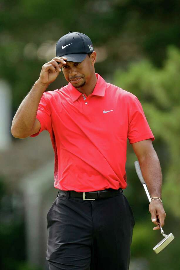 Tiger Woods reacts after putting on the 15th hole during the fourth round of the U.S. Open golf tournament at Merion Golf Club, Sunday, June 16, 2013, in Ardmore, Pa. (AP Photo/Gene J. Puskar) Photo: Gene J. Puskar / AP