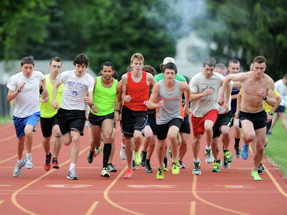 A group of young men participate in a race on the track during the Hudson Mohawk Roadrunner's Club meet at Colonie High School on Tuesday, June 18, 2013 in Colonie, N.Y. The club attracts people of all ages. (Lori Van Buren / Times Union) Photo: Lori Van Buren / 10022852A