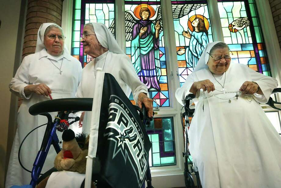 Sister Angelita Guzman (right) reacts to a humorous exchange between Sisters Guadalupe Medina (left) and Sister Rosalba Garcia, 85, while discussing the Salesian Sisters' love for the Spurs. Photo: Bob Owen / San Antonio Express-News