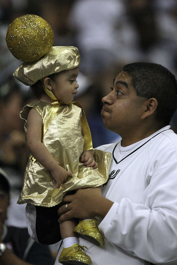 In 2007, Andy Macias dressed then-2-year-old daughter Lauren Elizabeth in a Larry O'Brien trophy costume. The Spurs won the NBA championship that year. Photo: San Antonio Express-News / File Photo