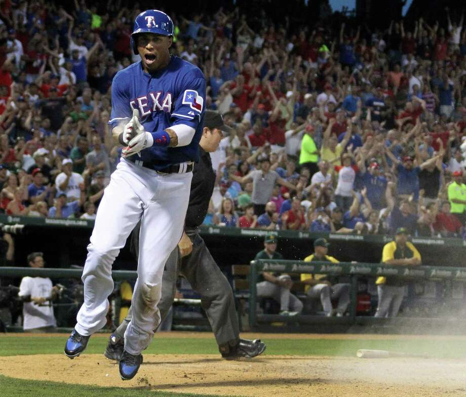 The Rangers' Leonys Martin exults after scoring the go-ahead run in the fifth inning against the Athletics. Texas' nine runs were the most since May 30. Photo: Louis DeLuca / McClatchy-Tribune News Service