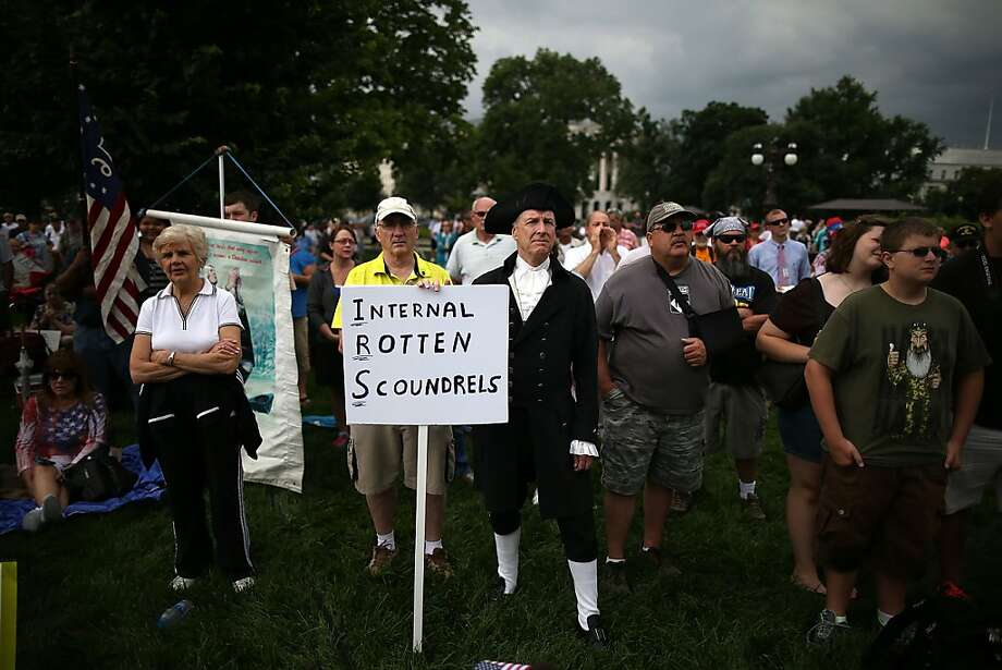 WASHINGTON, DC - JUNE 19: Members of the Tea Party participate in a rally at the U.S. Capitol, June 19, 2013 in Washington, DC. The group Tea Party Patriots hosted the rally to protest against the Internal Revenue Service's targeting Tea Party and grassroots organizations for harassment. (Photo by Mark Wilson/Getty Images) Photo: Mark Wilson, Getty Images