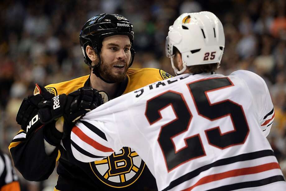 BOSTON, MA - JUNE 19:  Viktor Stalberg #25 of the Chicago Blackhawks and Adam McQuaid #54 of the Boston Bruins fight in the first period in Game Four of the 2013 NHL Stanley Cup Final at TD Garden on June 19, 2013 in Boston, Massachusetts.  (Photo by Harry How/Getty Images) Photo: Harry How, Getty Images
