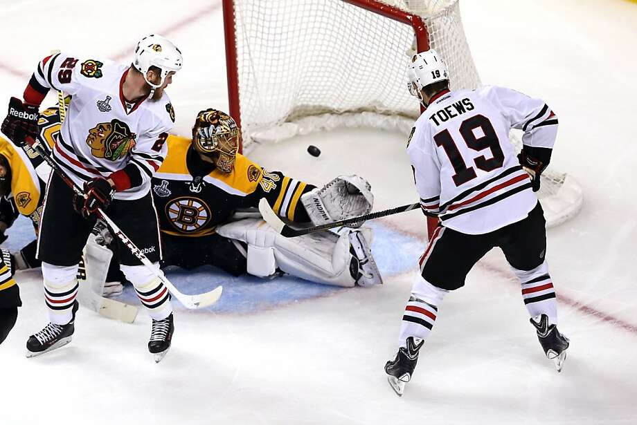 BOSTON, MA - JUNE 19:  Jonathan Toews #19 of the Chicago Blackhawks scores a goal against Tuukka Rask #40 of the Boston Bruins during the second period in Game Four of the 2013 NHL Stanley Cup Final at TD Garden on June 19, 2013 in Boston, Massachusetts.  (Photo by Bruce Bennett/Getty Images) Photo: Bruce Bennett, Getty Images
